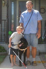 Photo of Children's visual companion dog Candy with Sawyer