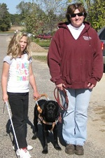 Photo of Children's visual companion dog Harley with Olivia